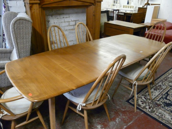 Ercol style dining table and six chairs - Sold for £520.00