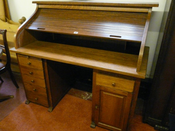 Reproduction oak roll top desk. - Sold for £300.00